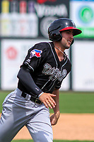 Lansing Lugnuts shortstop Kevin Smith (4) races home during a Midwest League game against the Wisconsin Timber Rattlers on May 8, 2018 at Fox Cities Stadium in Appleton, Wisconsin. Lansing defeated Wisconsin 11-4. (Brad Krause/Four Seam Images)
