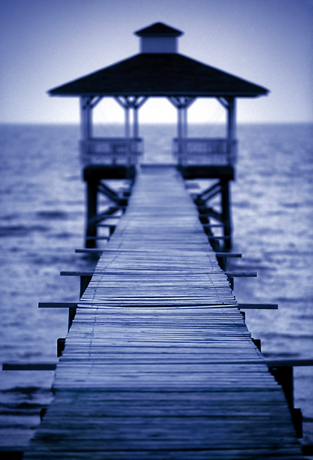 Wooden pier with gazebo juts out into the Gulf of Mexico.