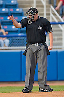 Home plate umpire Tyler Wilson signals a strike during a Carolina League game between the Kinston Indians and the Salem Red Sox at Lewis-Gale Field May 1, 2010, in Winston-Salem, North Carolina.  Photo by Brian Westerholt / Four Seam Images