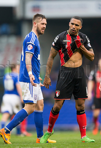 03.04.2015.  Ipswich, England. Skybet Championship. Ipswich Town versus AFC Bournemouth. Ipswich Town's Luke Chambers (left) is unimpressed as Bournemouth's Callum Wilson seems to have taken a dive in the box.