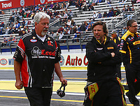 Feb 9, 2014; Pomona, CA, USA; NHRA funny car driver Del Worsham (right) with father Chuck Worsham during the Winternationals at Auto Club Raceway at Pomona. Mandatory Credit: Mark J. Rebilas-