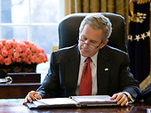 United States President George W. Bush reads over a draft of his State of the Union speech in the Oval Office of the White House in Washington, DC, Tuesday morning, January 31, 2006, in preparation for the annual address to the nation scheduled for this evening.  <br /> Mandatory Credit: Eric Draper / White House via CNP