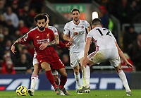 2nd January 2020; Anfield, Liverpool, Merseyside, England; English Premier League Football, Liverpool versus Sheffield United; Mohammed Salah of Liverpool  is held back by Muhamed Besic of Sheffield United as he attempts to take on John Egan of Sheffield United  - Strictly Editorial Use Only. No use with unauthorized audio, video, data, fixture lists, club/league logos or 'live' services. Online in-match use limited to 120 images, no video emulation. No use in betting, games or single club/league/player publications