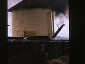 One of the C&amp;TS daily excursion trains passing the Lava water tank.<br /> C&amp;TS  Lava Tank, NM