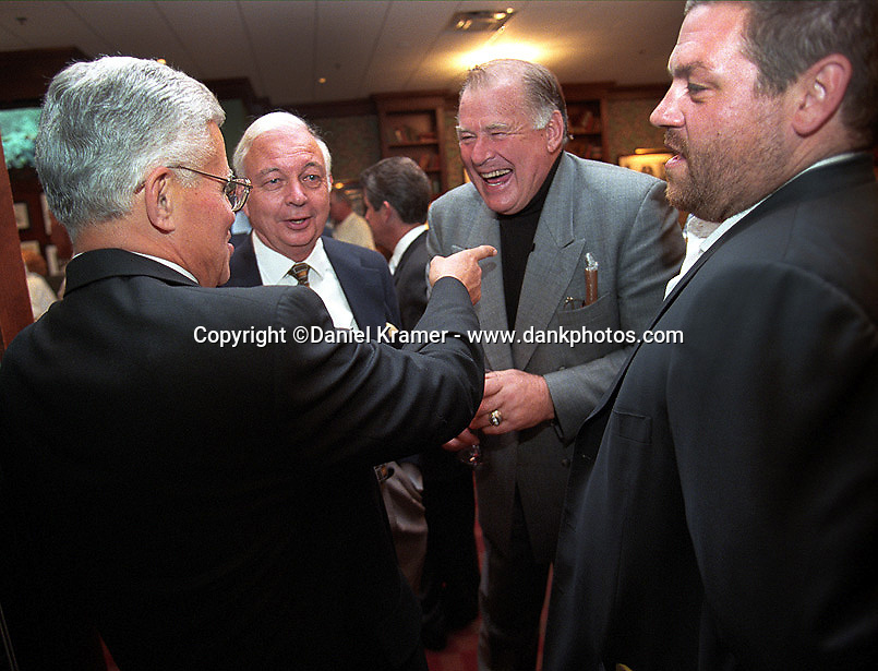 Vince Lombardi Jr. reminisces with sportswriter Bud Lea, former Green Bay Packer Jerry Kramer and film maker Ted Demme at the Lombardi Legends reunion at Lombardi's Steakhouse in Appleton, Wisconsin in September of 2001. Demme, who was working on a feature-length film about Lombardi's Packers, died only four months later.