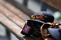Boston Red Sox hat sits on top of a Rawlings glove in the dugout during a spring training game against the Tampa Bay Rays on March 25, 2014 at Charlotte Sports Park in Port Charlotte, Florida.  Boston defeated Tampa Bay 4-2.  (Mike Janes/Four Seam Images)