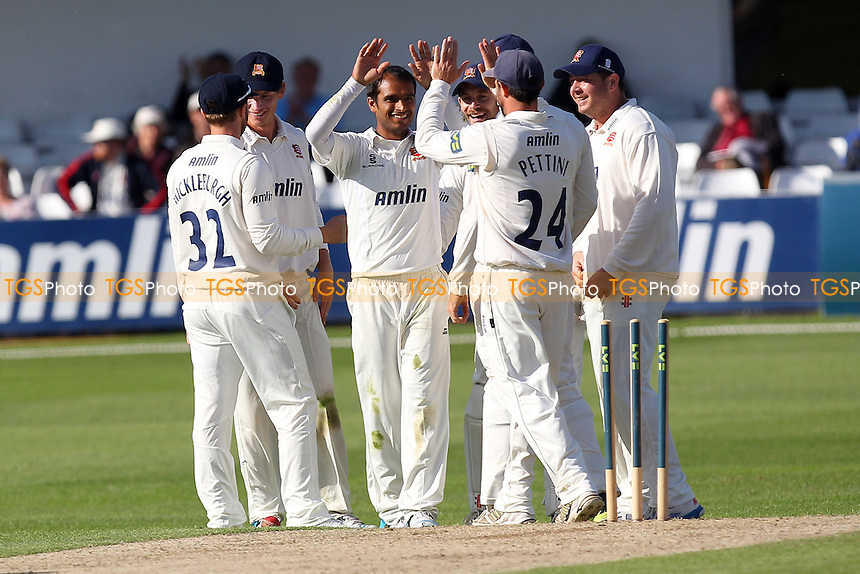 Tanweer Sikander of Essex (C) is congratulated on the wicket of Hashim Amla - Essex CCC vs Surrey CCC - LV County Championship Division Two Cricket at the Essex County Ground, Chelmsford, Essex - 25/05/14 - MANDATORY CREDIT: Gavin Ellis/TGSPHOTO - Self billing applies where appropriate - 0845 094 6026 - contact@tgsphoto.co.uk - NO UNPAID USE