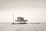 Thimbles Islands. Summer small cottage on rocky granite island.