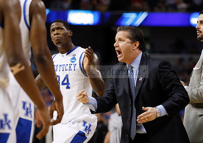 Coach Calipari yells at the team during a time out in the first half of UK's second round NCAA tournament win, 71-63, against West Virginia at the St. Pete Times Forum in Tampa, Florida on Saturday, March 19, 2011.  Photo by Britney McIntosh | Staff
