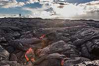 A man pauses during his hike through lava fields in Hawai'i Volcanoes National Park, Hawai'i Island.
