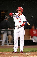 Harrisburg Senators second baseman Rick Hague (5) wipes the rain off his bat during a game against the New Britain Rock Cats on April 28, 2014 at Metro Bank Park in Harrisburg, Pennsylvania.  Harrisburg defeated New Britain 9-0.  (Mike Janes/Four Seam Images)