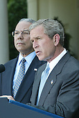 "United States President George W. Bush announces a blueprint for Palestinian statehood with a statement in the Rose Garden at the White House, June 24, 2002,  in Washington, as U.S. Secretary of State Colin Powell looks on.   In his statement, President Bush urged the Palestinian people to replace Yasser Arafat with leaders ""not compromised by terror''  and to adopt democratic reforms that could produce an independent Palestine within three years.<br /> Credit:  Ron Sachs / CNP"
