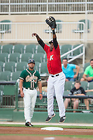 Kannapolis Intimidators first baseman Alexander Simon (23) leaps for a high throw during the game against the Greensboro Grasshoppers at CMC-Northeast Stadium on June 9, 2015 in Kannapolis, North Carolina.  The Intimidators defeated the Grasshoppers 6-4.  (Brian Westerholt/Four Seam Images)