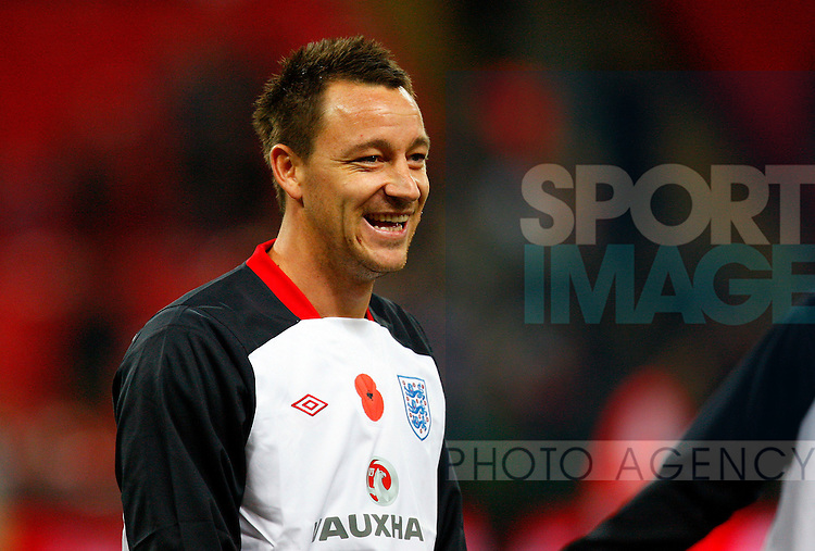 John Terry of England warms up during the friendly match between England and Spain at Wembley Stadium, London, England, on November 12, 2011