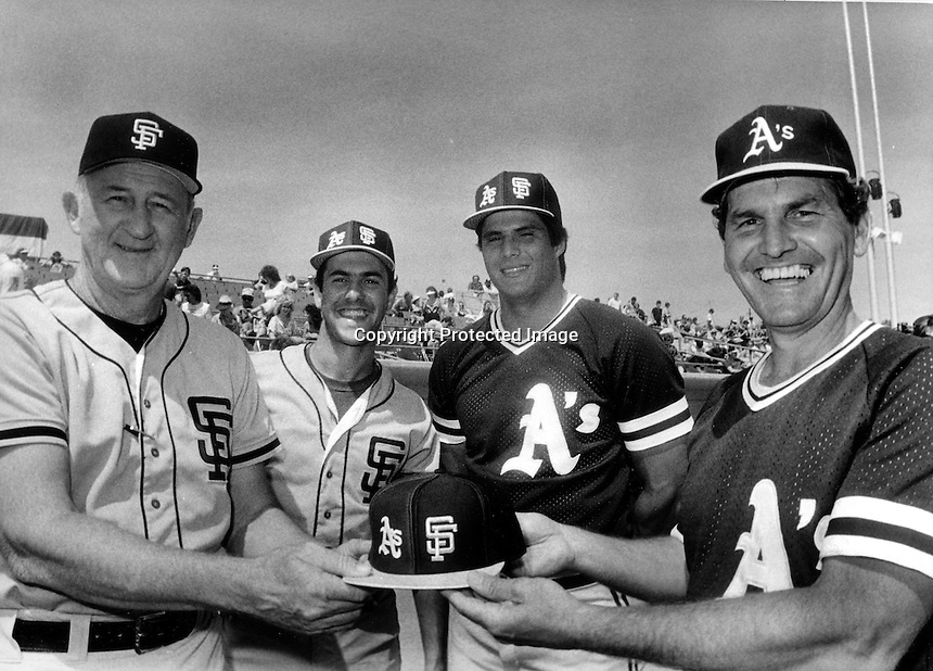 "A's and Giants get ready for ""Battle of the Bay"" pre-season 1986. Giant manager Roger Craig, Will Clark, Jose Canseco, and A's manager Jackie Moore..(photo 1986 by Ron Riesterer)"