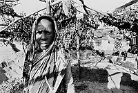 The crackdown against Rohingya in late 2009 displaced thousands of Rohingya. Many like this woman fled to Kutupalong Makeshift Camp for protection. During the crackdown the camp swelled to over 34,000 people. (2009)