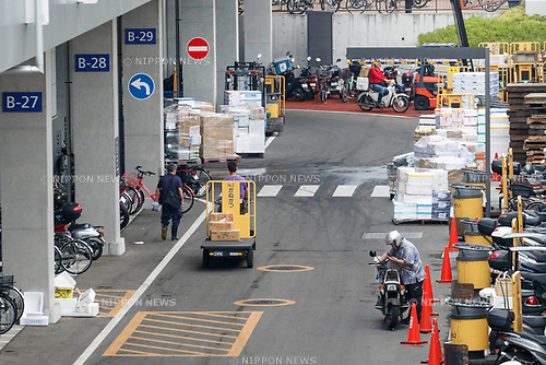Workers are seen at the new Tokyo Metropolitan Central Wholesale Market which opened in Toyosu on October 11, 2018, Tokyo, Japan. The new fish market replaces the famous Tsukiji Fish Market which closed for the last time on Saturday 6th October. The move to Toyosu was delayed for almost 2 years because of fears over toxins found in water below the new market. (Photo by Rodrigo Reyes Marin/AFLO)
