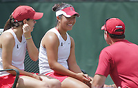 STANFORD, CA - April 9, 2011:  Nicole Gibbs and doubles partner Kristie Ahn, with Coach Frankie Brennan during Stanford's 5-2 victory over Washington at Stanford, California on April 9, 2011.