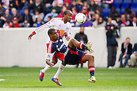 Jose Moreno (9) of the New England Revolution and Dane Richards (19) of the New York Red Bulls. The New York Red Bulls defeated the New England Revolution 1-0 during a Major League Soccer (MLS) match at Red Bull Arena in Harrison, NJ, on April 28, 2012.