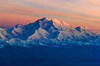 Aerial of Mt. Denali and the Alaska Range mountains at sunset, view looking southwest, Denali National Park, Interior, Alaska.