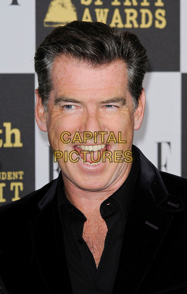 PIERCE BROSNAN.The 25th Annual Film Independent Spirit Awards at the LA Live Event Deck in Los Angeles, California, USA..March 5th, 2010  .headshot portrait black mouth open funny .CAP/ROT.©Lee Roth/Capital Pictures