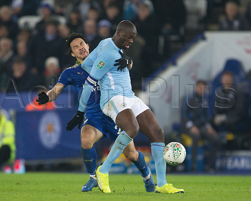 19th December 2017, King Power Stadium, Leicester, England; Carabao Cup quarter-final, Leicester City versus Manchester City; Shinji Okazaki of Leicester City fouls Yaya Toure of Manchester City