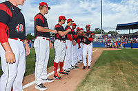 Batavia Muckdogs catcher Pablo Garcia (7) fist bumps teammates during introductions before a game against the State College Spikes on June 22, 2016 at Dwyer Stadium in Batavia, New York.  State College defeated Batavia 11-1.  (Mike Janes/Four Seam Images)
