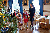 First Lady Michelle Obama walks with children past the official White House Christmas Tree in the Blue Room, November 30, 2011. Mrs. Obama welcomed military families to the White House for for the first viewing of the 2011 holiday decorations. .Mandatory Credit: Lawrence Jackson - White House via CNP