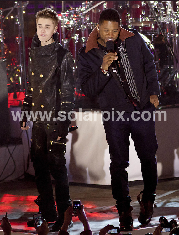 **ALL ROUND PICTURES FROM SOLARPIX.COM**                                             **SYNDICATION RIGHTS FOR UK, AUSTRALIA, DENMARK, PORTUGAL, S. AFRICA, SPAIN & DUBAI (U.A.E) & ASIA (EXCLUDING JAPAN) ONLY**                                                                                  Caption:  Justin Bieber  Pre-Tapes Rockefeller Centre Christmas Tree Lighting Special with Guests Usher and Busta Rhymes  in New York City                                                                           This pic:Justin Bieber, Busta Rhymes                                                                                             JOB REF:14241        PHZ       DATE: 23.11.2011                                                           **MUST CREDIT SOLARPIX.COM OR DOUBLE FEE WILL BE CHARGED**                                                                      **MUST AGREE FEE BEFORE ONLINE USAGE**                               **CALL US ON: +34 952 811 768 or LOW RATE FROM UK 0844 617 7637**