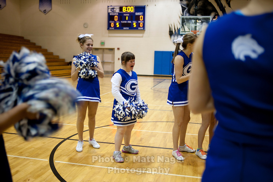 From left, Grandview High School unified basketball team cheerleaders Jenny Kern (cq) and Charlotte McFall (cq) cheer the starting players before a game against Overland High School at Grandview High School in Aurora, Colorado, Wednesday, February 1, 2012. Unified sports teams, an outgrowth of the Special Olympics, are teams with both special needs and traditional high school students as players. The idea is that special needs kids shouldn't be separated and be allowed to participate in a competitive games as well at their schools...Photo by Matt Nager