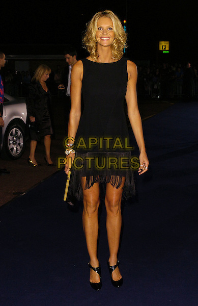 ELLE MACPHERSON.At the Giorgio Armani RED One Night Only .Fashion & Music Party, Earls Court, .London, England, September 21st 2006..full length black dress fringed tassles tanned .Ref: CAN.www.capitalpictures.com.sales@capitalpictures.com.©Can Nguyen/Capital Pictures