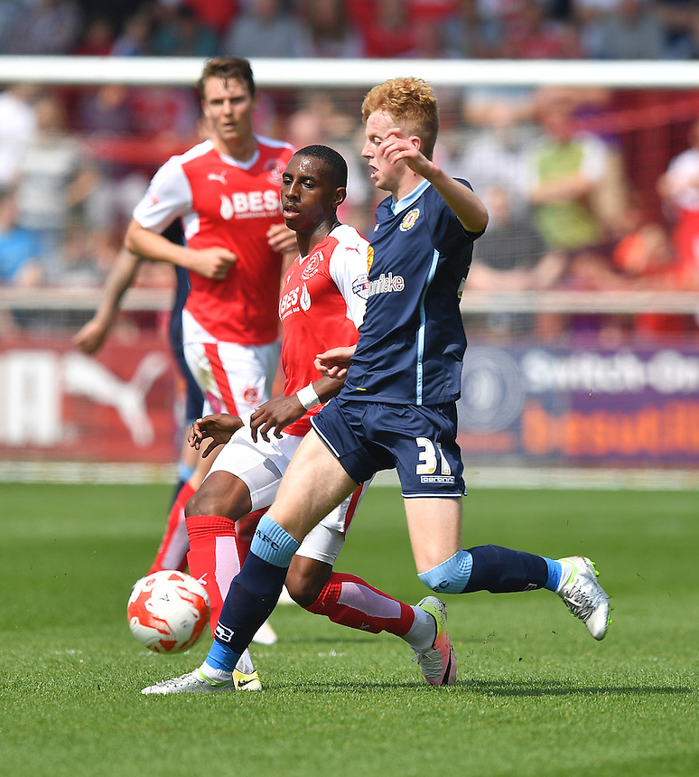 Fleetwood Town's Amari'i Bell gets the ball past Crewe Alexandra's Charlie Kirk<br /> <br /> Photographer Dave Howarth/CameraSport<br /> <br /> Football - The Football League Sky Bet League One - Fleetwood Town v Crewe Alexandra - Sunday 8th May 2016 - Highbury Stadium - Fleetwood    <br /> <br /> &copy; CameraSport - 43 Linden Ave. Countesthorpe. Leicester. England. LE8 5PG - Tel: +44 (0) 116 277 4147 - admin@camerasport.com - www.camerasport.com