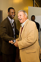 TALLAHASSEE, FLA. 10/26/13-FSU-NCSTATE102613CH-Former Florida State Football Coach Bobby Bowden talks with former player Mario Edwards after leaving a news conference prior to the North Carolina State game Saturday at Doak Campbell Stadium in Tallahassee. This was the first time Bowden has been at a Seminole game since coaching the 2009 season. <br /> COLIN HACKLEY PHOTO