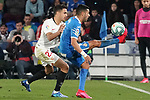 Getafe CF's Angel Rodriguez (r) and Sevilla FC's Sergio Reguilon during La Liga match. February 23,2020. (ALTERPHOTOS/Acero)