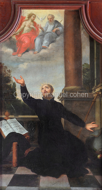 Painting of St Ignatius of Loyola, 1491-1556, founder of the Society of Jesus or Jesuit Order, praying to find grace in the Holy Trinity, as described in his Spiritual Exercises, by Jean Helart, 1618-85, French painter, in the wooden panelling of the refectory of the Ancien College des Jesuites or Former Jesuit College in Reims, Marne, Champagne-Ardenne, France. The College was built 1619-78 and is now the Euro-American campus of Sciences Po, or the Institut d'Etudes politiques de Paris, and the FRAC Champagne-Ardenne. It is listed as a historic monument. Picture by Manuel Cohen