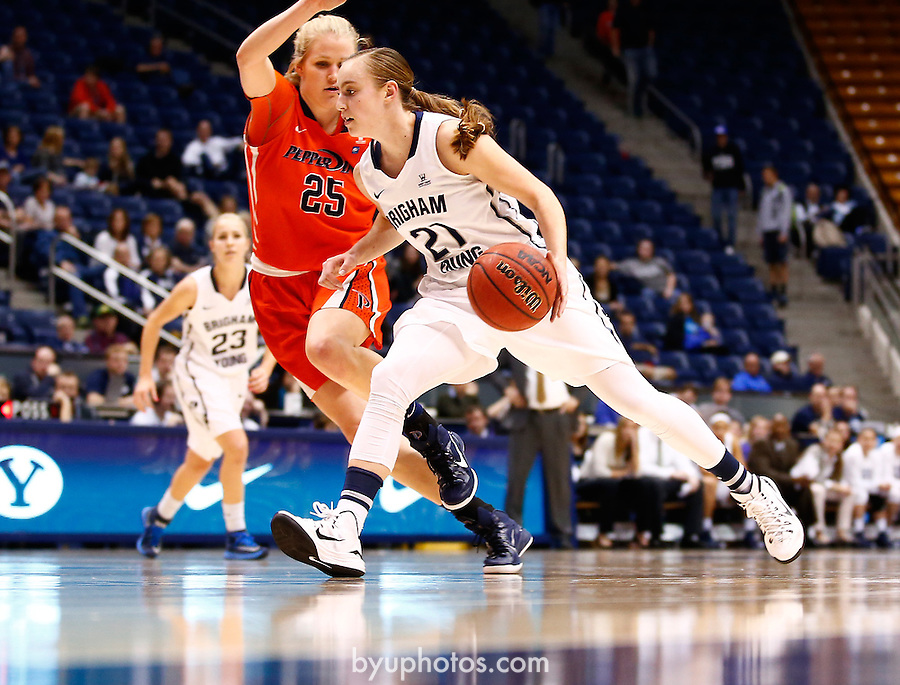 _SW25055<br /> <br /> BYU's Lexi Eaton (21) drives on Pepperdine's Tessa Emmerson (25). Eaton scored a career high 37 points to help the BYU Basketball team defeat Pepperdine 77-58 to give Jeff Judkins his 300th win as BYU's Head Coach.<br /> <br /> February 5, 2015<br /> <br /> Photo by Jaren Wilkey/BYU<br /> <br /> &copy; BYU PHOTO 2013<br /> All Rights Reserved<br /> photo@byu.edu  (801)422-7322