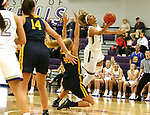 SIOUX FALLS, SD - DECEMBER 7: Gloria Mulumba #21 from the University of Sioux Falls scoops a shot after being fouled by Lindsay Dorr #40 from Concordia St. Paul during their game Friday night at the Stewart Center in Sioux Falls, SD. (Photo by Dave Eggen/Inertia)
