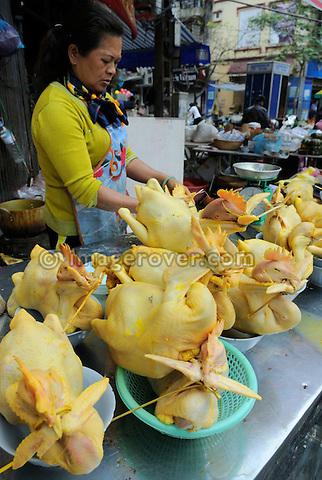 Asia, Vietnam, Hanoi. Hanoi old quarter. Decorated chicken on market.