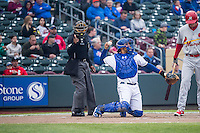 Home plate umpire A.J. Johnson and Francisco Pena (26) of the Omaha Storm Chasers during the game against the Memphis Redbirds in Pacific Coast League action at Werner Park on April 24, 2015 in Papillion, Nebraska.  (Stephen Smith/Four Seam Images)