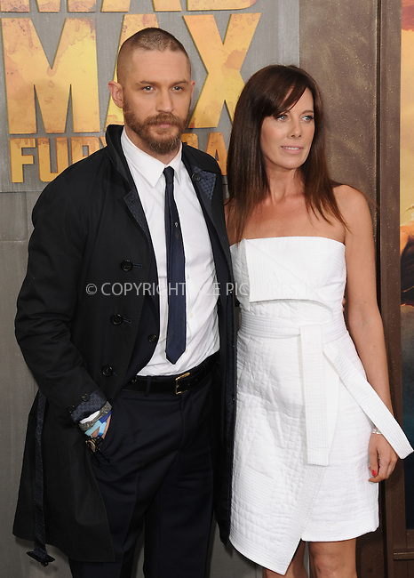 WWW.ACEPIXS.COM<br /> <br /> May 7 2015, LA<br /> <br /> Tom Hardy and Kelly Marcel arriving at the premiere  'Mad Max: Fury Road' at the TCL Chinese Theatre on May 7, 2015 in Hollywood, California. <br /> <br /> By Line: Peter West/ACE Pictures<br /> <br /> <br /> ACE Pictures, Inc.<br /> tel: 646 769 0430<br /> Email: info@acepixs.com<br /> www.acepixs.com