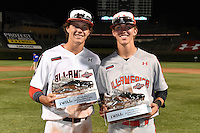 Ryan Mountcastle (5) of Paul J. Hagerty High School in Winter Springs, Florida and LT Tolbert (1) of IMG Academy in Piedmont, South Carolina pose with their MVP trophy after the Under Armour All-American Game on August 16, 2014 at Wrigley Field in Chicago, Illinois.  (Mike Janes/Four Seam Images)