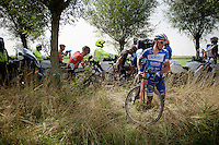 James Vanlandschoot (BEL/Wanty-Groupe Gobert) takes a short-cut as the race is neutralised for a first time and chaos takes over.<br /> <br /> 90th Schaal Sels 2015