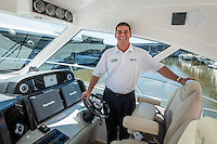 Jim Hunt on deck of Raymarine. Photo by Debi Pittman Wilkey