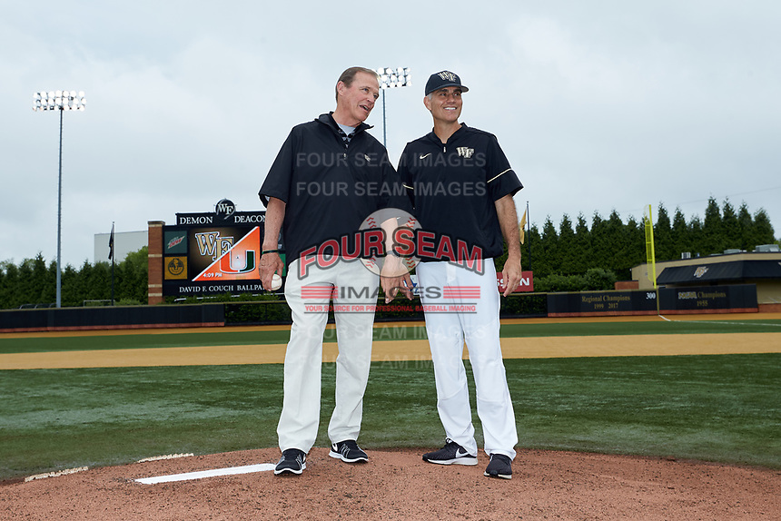 Former Wake Forest Athletic Director Ron Wellman (left) is joined on the pitchers mound by Wake Forest Demon Deacons head coach Tom Walter (16) as Wellman prepares to throw out the ceremonial first pitch prior to the game against the Miami Hurricanes at David F. Couch Ballpark on May 11, 2019 in  Winston-Salem, North Carolina. The Hurricanes defeated the Demon Deacons 8-4. (Brian Westerholt/Four Seam Images)