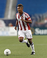 Chivas USA forward Juan Agudelo (11) brings the ball forward. In a Major League Soccer (MLS) match, the New England Revolution tied Chivas USA, 3-3, at Gillette Stadium on August 29, 2012.