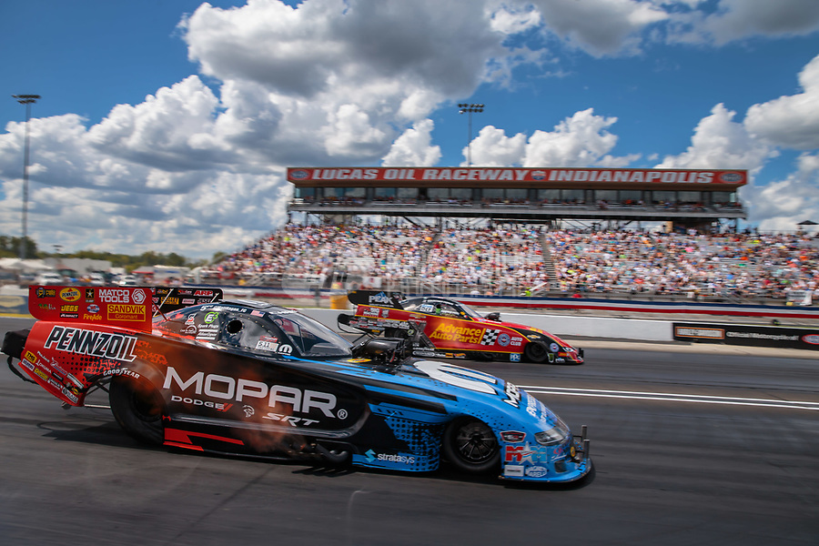 Sep 3, 2018; Clermont, IN, USA; NHRA funny car driver Matt Hagan (near) races alongside Courtney Force during the US Nationals at Lucas Oil Raceway. Mandatory Credit: Mark J. Rebilas-USA TODAY Sports