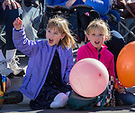 Young girls watching the Nevada Day Parade on Saturday, October 29, 2016.