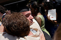 Nick Culbertson, of Dunhellen, New Jersey, hugs his grandmother Lillian Culbertson after receiving his diploma at the Quincy House ceremony during Harvard University Commencement on May 26, 2011, in Cambridge, Massachusetts, USA.<br /> <br /> Photo: Photo: M. Scott Brauer for the Star-Ledger