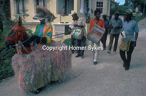BARBADOS HOBBY HORSE WEST INDIES .<br /> The music that the attendants play and the way the Hobby Horse prances about is very similar to both the Padstow Hobby Horse, Cornwall, England, the Minehead Hobby Horse and the Dunster Hobby Horse Somerset UK.  Attendants playing drums accompany both Minehead and the Dunster Horse. This Hobby Horse looks much more like the Minehead Horse and Dunster Horse and perhaps was brought to the West Indies by sailors from Great Britain