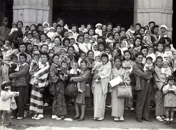 young parents with there new born baby at a baby contest event Japan 1947